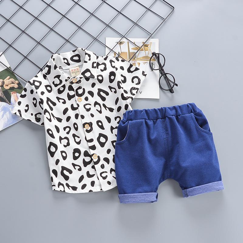 8f8531ef3 Compre Conjuntos De Ropa De Algodón Para Niños Bebé Recién Nacido Bebé Niño  Pequeño Camisas De Moda + Pantalones Cortos Trajes De Entrenamiento De Boda  De 2 ...