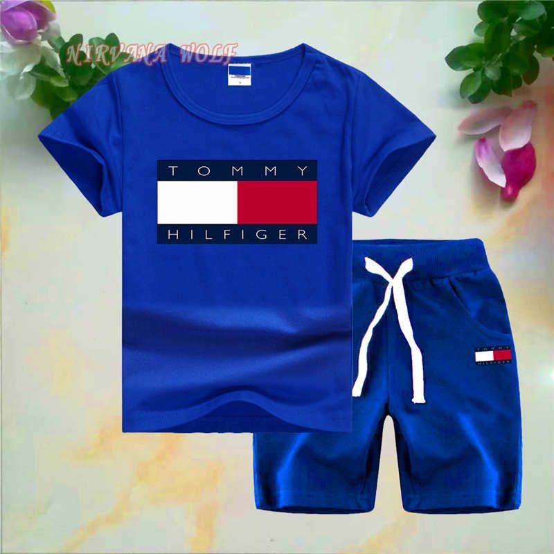 T0MMYLogo Luxury Designer Toddler Summer Kids Baby Boy Set de algodón Camiseta de manga corta Camiseta Tops Pantalones cortos Pantalones Conjunto de trajes