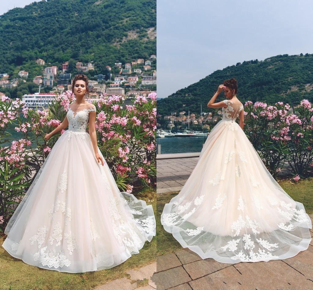 9109af6d2192fd 2019 Romantic Light Pink With White Lace Appliques Wedding Dresses A Line  Cap Sleeve Sheer Neck