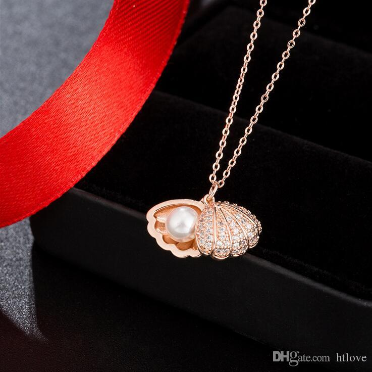 61e77edf618c Compre Collar De Concha De Oro Lucky Imitación Perla Colgante Cadena  Collares Moda Vintage Concha De Moda De Lujo Diseñador Joyas De Ocean Beach  A  3.85 Del ...