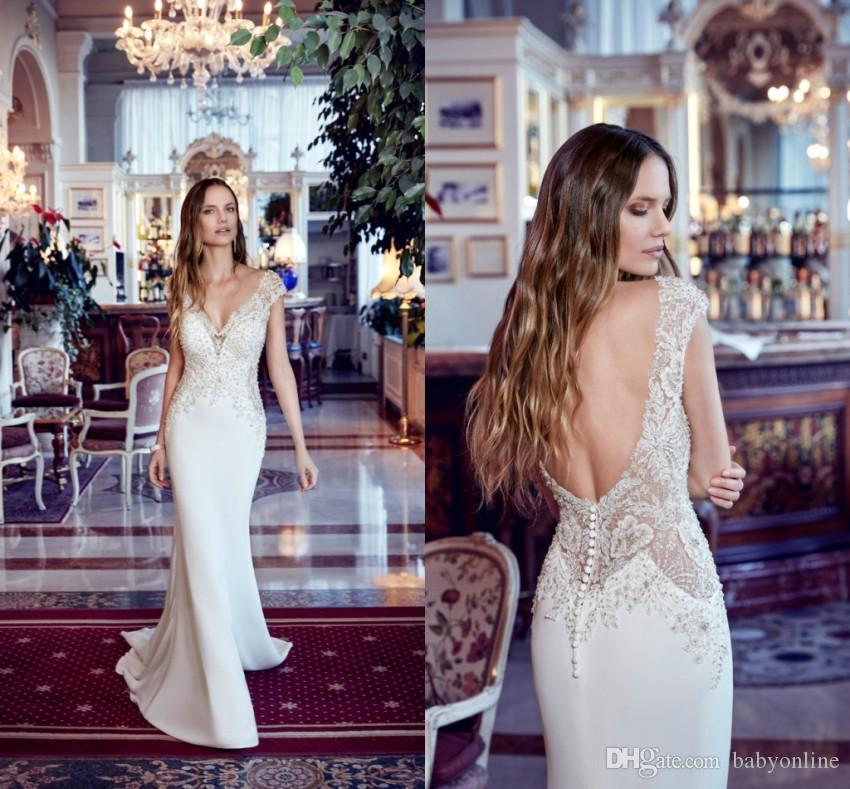 Designed Mermaid Wedding Dresses 2019 Sheer Cap Sleeve V Cut Backless With Buttons Plunging Neckline Applique Bridal Gowns With Court Train