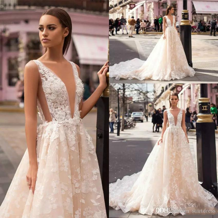 0ca18864a95 Designer Champagne Rustic Wedding Dresses A Line Deep Plugging Appliqued  Lace Bohemian Bridal Dress Sexy Long Train See Through Lebanon Gown Modest  Bridal ...
