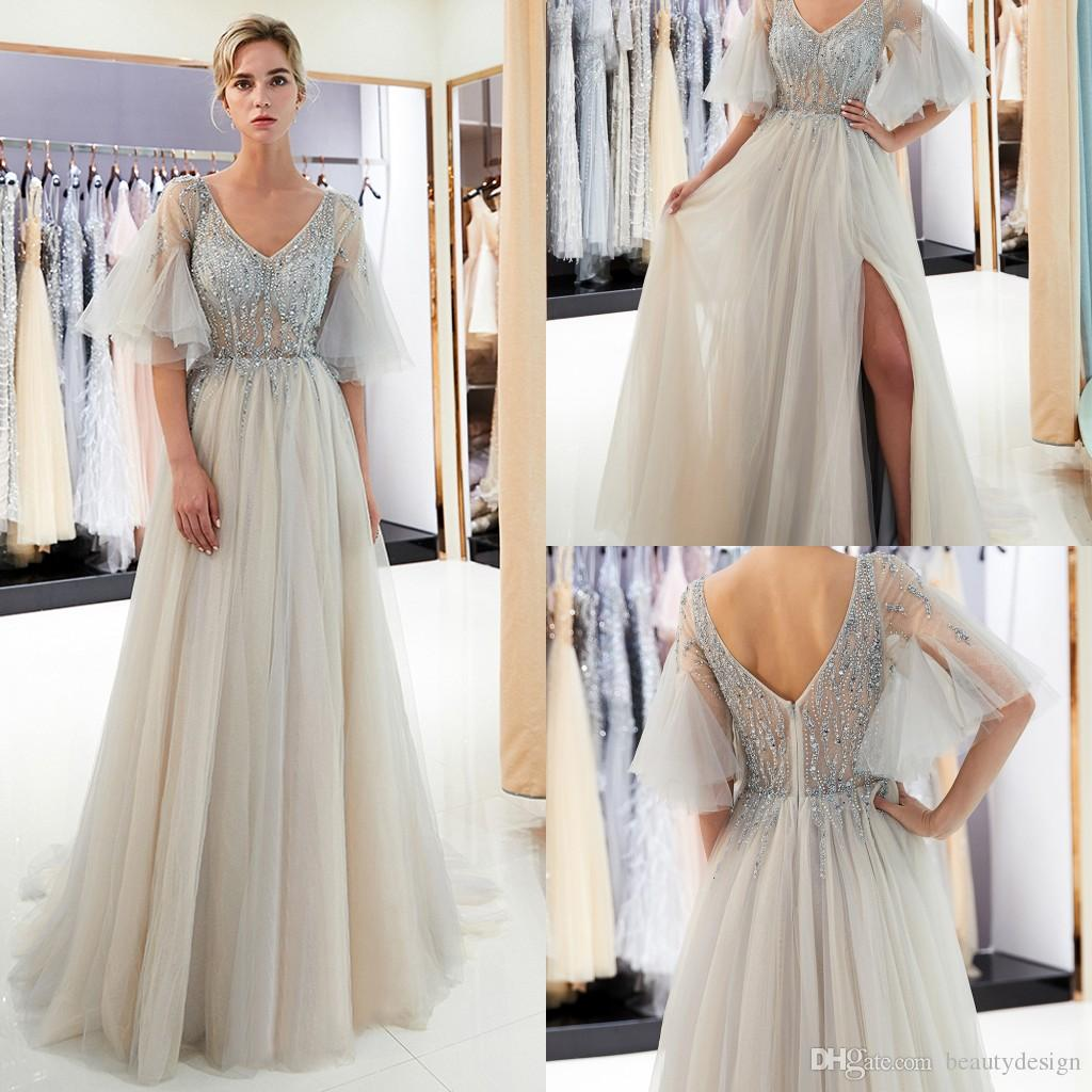 2d72f6c0ecee Champagne Silver Short Juliet Sleeves Prom Dresses Illusion Bodice Crystal  Beaded Designer Formal Evening Wear Gray Graduation Party Gown Cheap  Cocktail ...