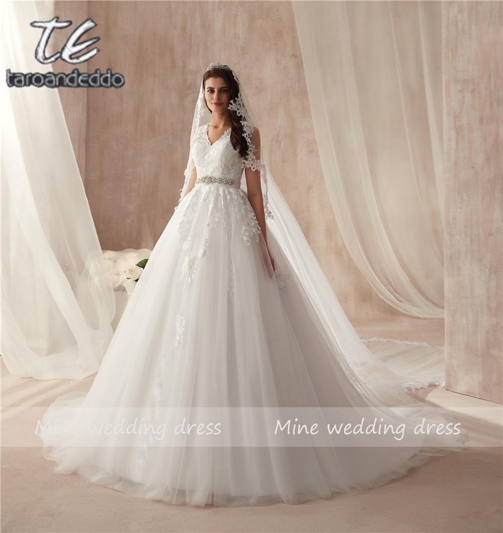 Haut V Cou Délicate Dentelle Applique Robe De Mariée Illusion Retour Perles Sash Ceinture Robe De Mariée Avec Un Arc énorme Robe De Noiva