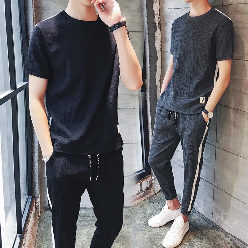 50e49d2bb Hombres Conjunto de ropa de verano 2019 Nuevo Casual O-cuello de manga  corta camiseta pantalones dos piezas Set M-3XL ropa de talla grande de alta  ...