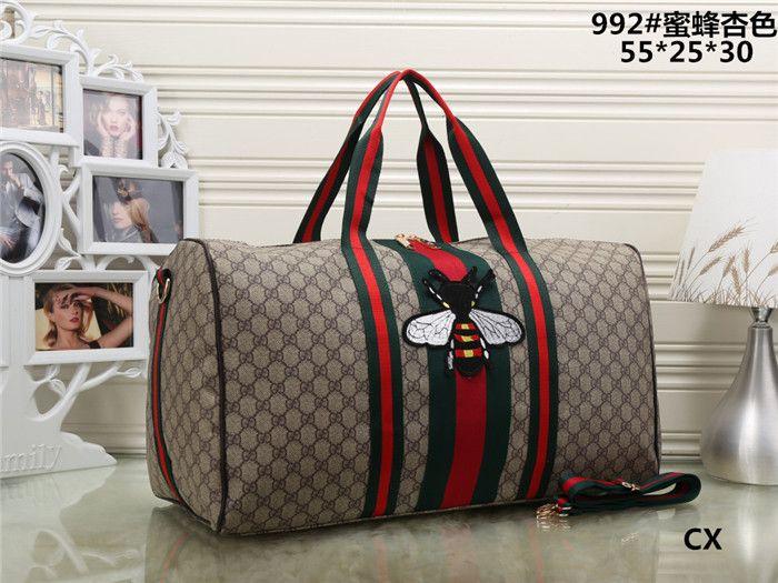 9ce0f230a5cb Top Quality 2019 New Fashion Men Women Travel Bag Duffle Brand ...