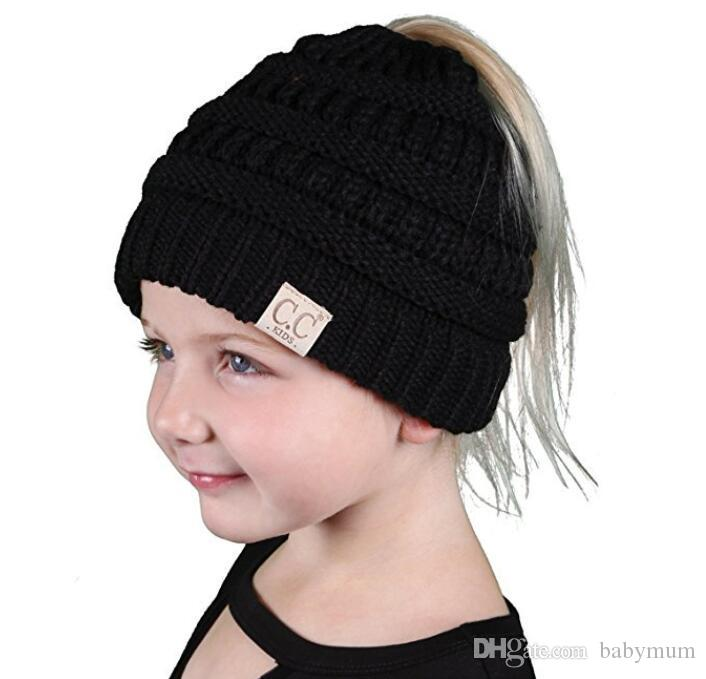 3d0a73debdb Children CC Ponytail Messy Bun Beanie Solid Crochet Hats Soft Stretch Cable  Knit Messy Cap Kids Winter Warmer Beanie Hat Canada 2019 From Babymum