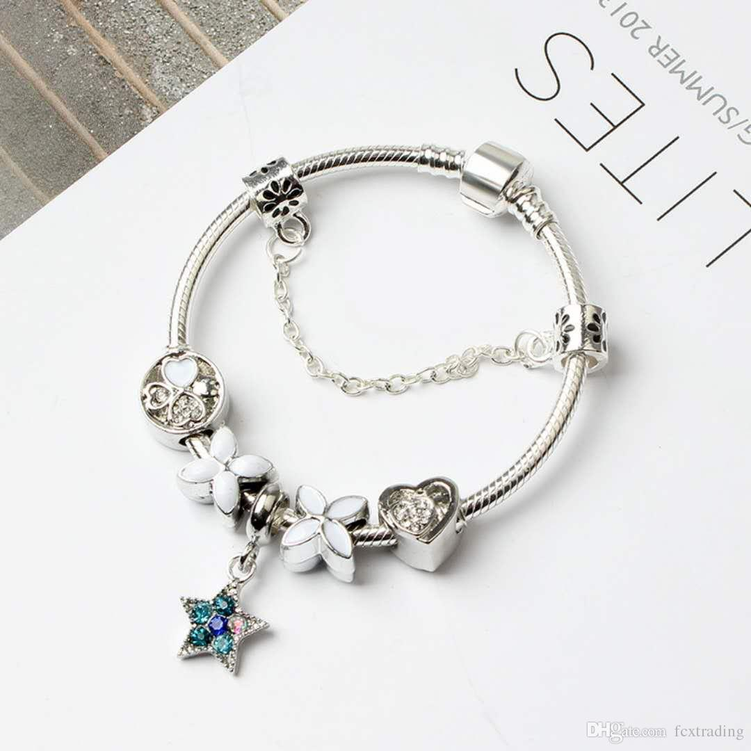 Sterling Silver Bracelet With 17 Sterling Silver Charms Charms & Charm Bracelets