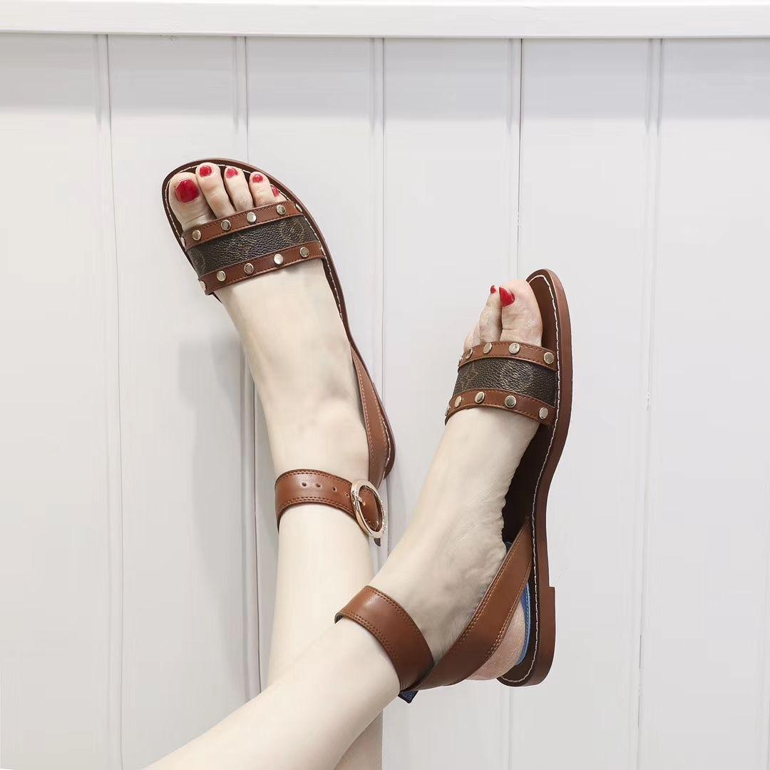 cf53d3a835e Compre Verano 2019 Zapatos De Mujer Nuevos Sandalias Planas Romanas Mujeres  Piel Italiana Zapatos De Tacón Plano Antideslizantes De Tacón Plano Mujer  ...