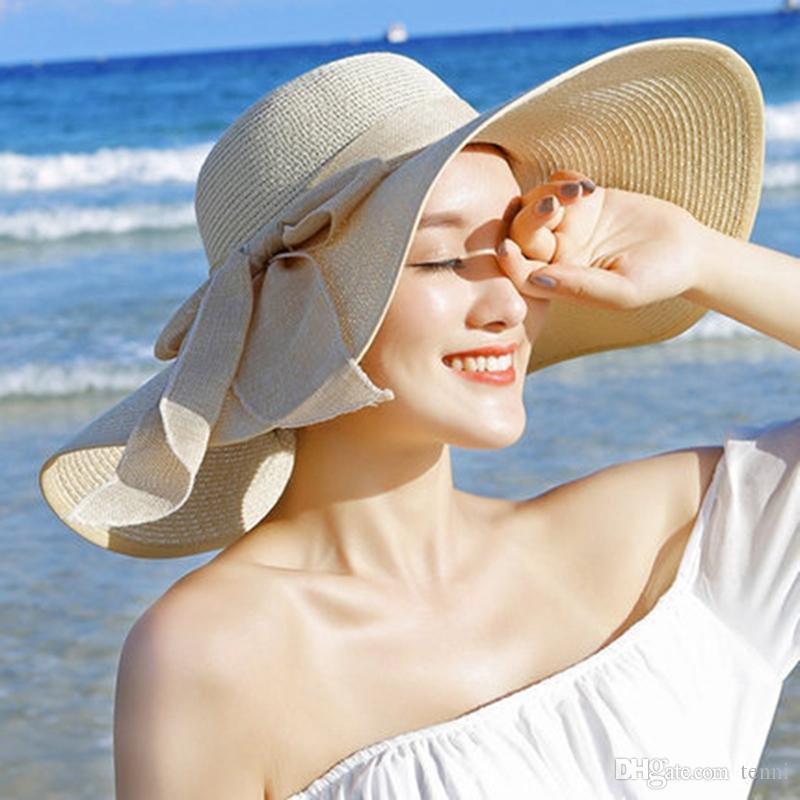 Compre Nuevo Verano De Ala Grande De Paja Sombrero Para El Sol Ropa De Playa  Moda Floppy De Ala Ancha Sombrero Para El Sol Playa De Bowknot Plegable  Casual ... ab5484b749f