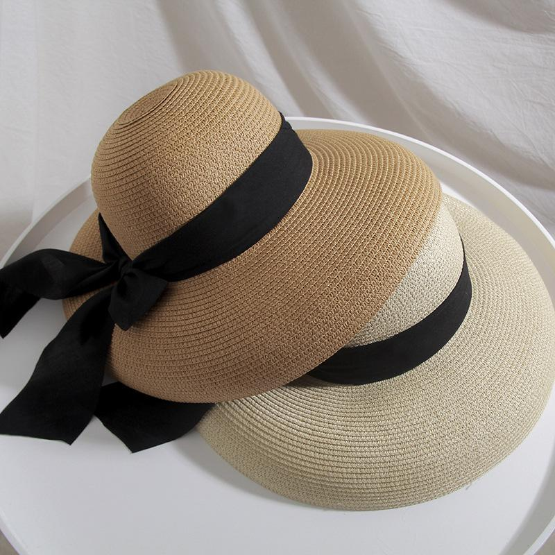 a7ee8f3dc98ed Bell Shaped Straw Hat Female Big Bow Knot Sunscreen Beach Hat For Seaside  Holiday In Spring And Summer Sun Hats Sun Hat From Nancyjilllee