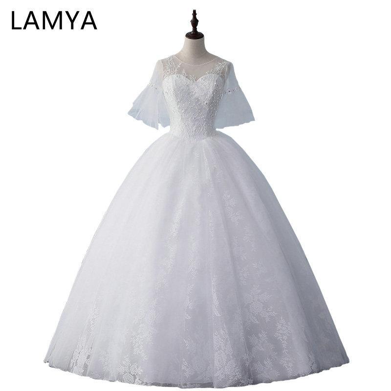 557cc96316 Compre Venta Al Por Mayor De Manga Corta Llamarada Vestidos De Novia 2019  Alibaba Ata Para Arriba El Vestido De Bola Wed Vestido Modificado Para  Requisitos ...