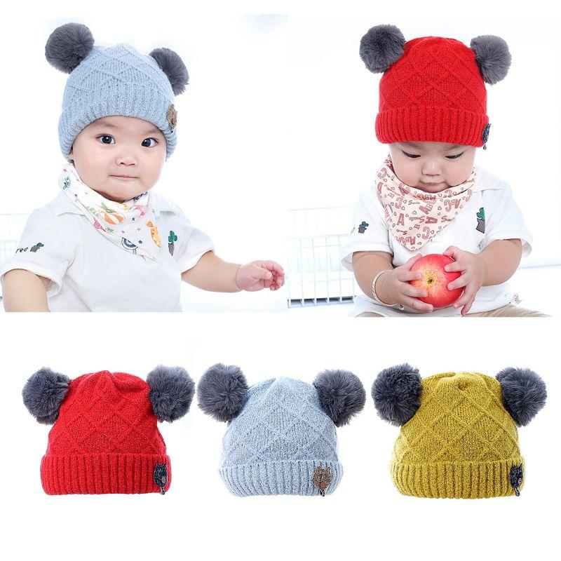f1451ef168c 2019 Infant Baby Winter Rhombic Knitted Cuffed Hat Solid Color Fluffy  Pompom Ball Beanie Cap Thicken Double Layered Button Cat Appliq From  Jumeiluo