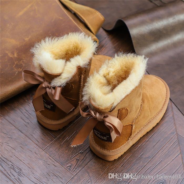 8d80a10b2 Compre Moda Arco Lindo Botas De Nieve Para Niños Mariposa Nudo Niñas  Invierno Cálido Zapatos Negro Australia Piel Un Bebé Zapatos De Invierno A   81.22 Del ...