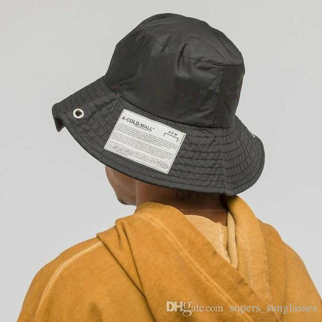 Acquista 2019 Ultime Donne Uomini Hip Hop F   W Giappone Cappelli ACW A  COLD WALL Cappello Pescatore Moda Cappello ACW Etichetta Cappellino Nero  High Street ... e6b2b79201ce