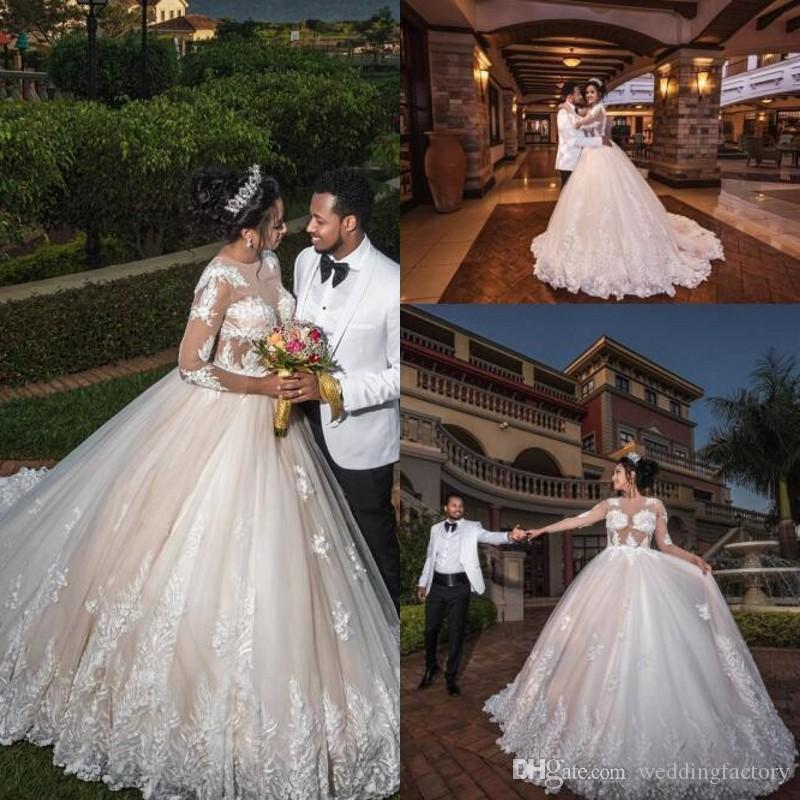 2019 Arabic Illusion Top Long Sleeve Wedding Dresses Lace Appliques See Through Bodice Tulle Bridal Gowns Sweep Train High Quality