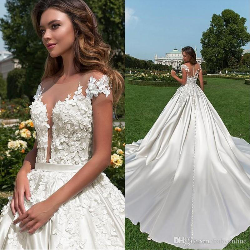 ddc55f1b85 Discount New Cap Sleeve 2019 Country Garden Wedding Dresses A Line Sheer  Neck Lace Appliques Beaded Buttons Back Bridal Gowns Destination Wedding  Dresses ...