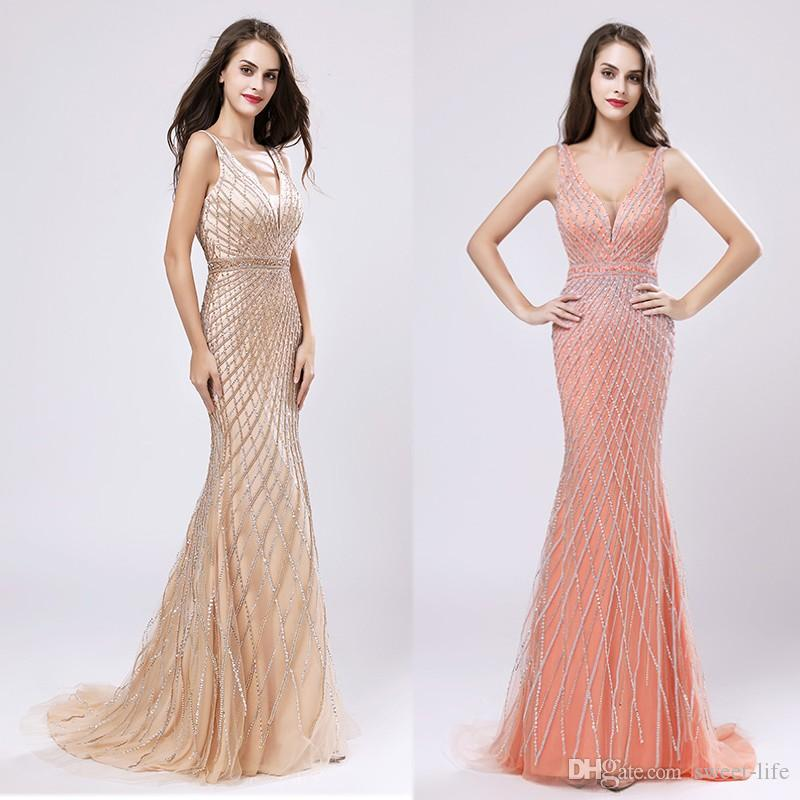 ccae38493f Luxury Long Champagne Beading Mermaid V Neck Evening Dresses 2019 New  Arrival Sexy Backless In Stock Sweep Train Prom Dress Party Gowns Classic Prom  Dresses ...