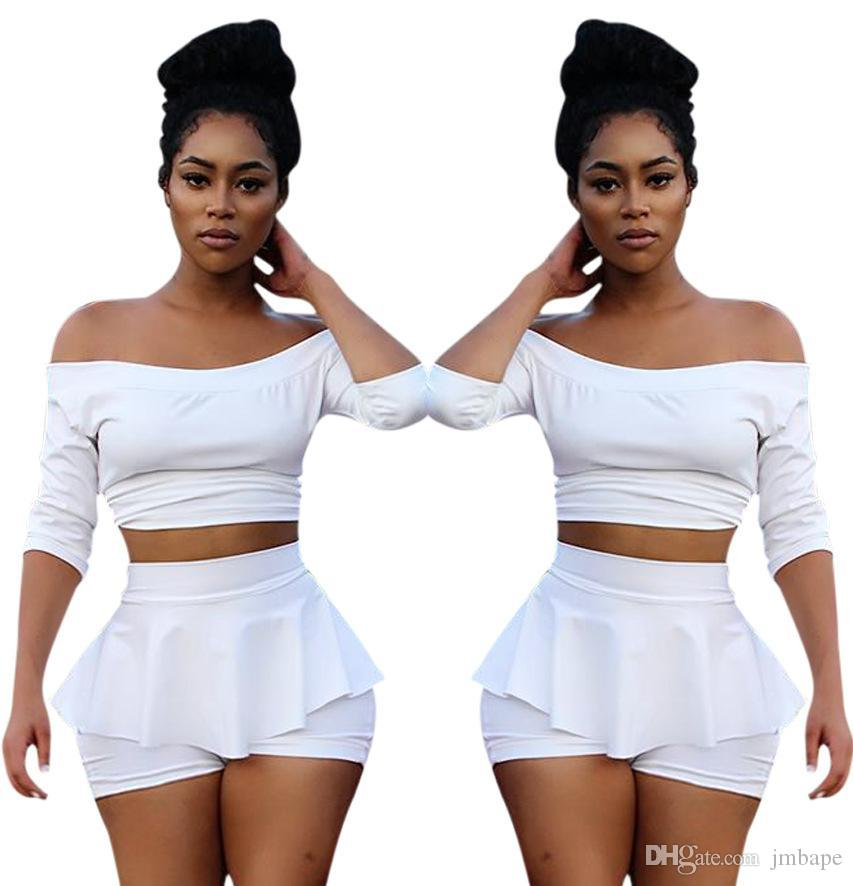 946c7b36dd38b 2019 Fashionable Style Sexy Short Skirt Pleats One Character Collar Tight  Belly Fashion White Two Piece Set Of Nightclubs From Jmbape