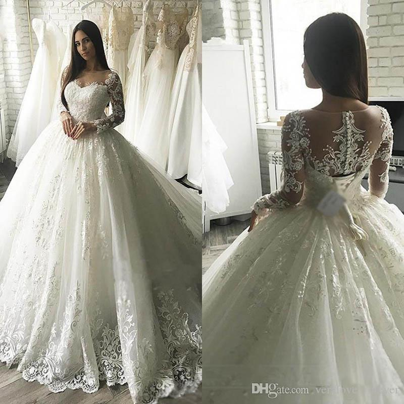 2019 Modest Arabic Princess Ball Gown Wedding Dresses Lace Appliqued Long Sleeve Sheer Back With Button Covered Belt Long Dubai Brides Gowns