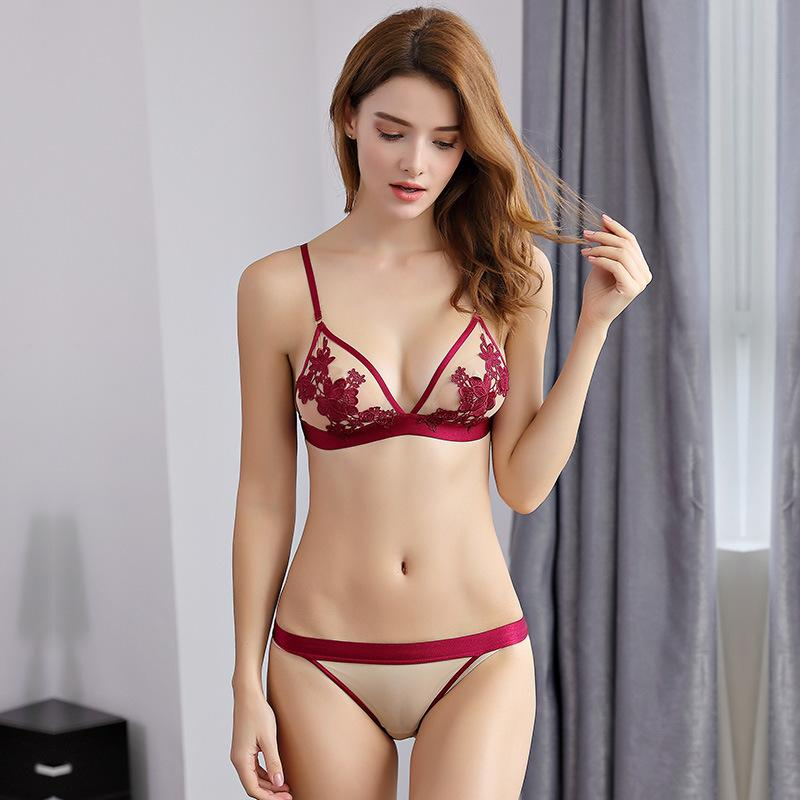 d1c977482dd 2019 New Super Thin Sexy Triangle Cup Womens Bra And Panty Set Lace Floral  Embroidery 3 4 Cup Wire Free Tow Hook And Eye From Yuhuicuo