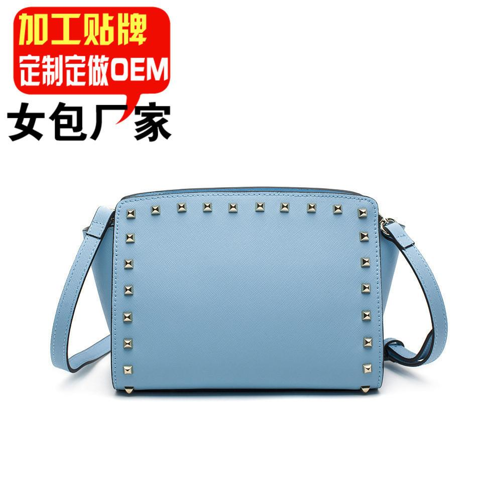 Belle2019 Toutes les fleurs Guangzhou bagages et sacs en cuir Production de production de sac en cuir finaliser la conception femme sacoche oblique Satchel Rivet Package