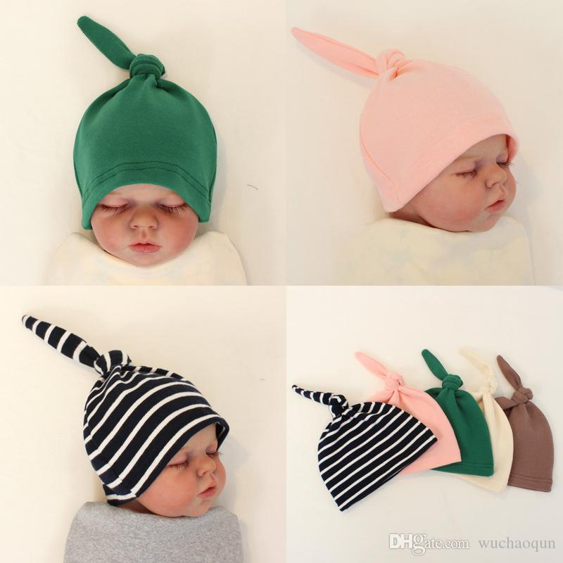 5b6159639f2 2019 Hot Sale Baby Beanie Hat Top Knot Stretchy Soft Newborn Accessoriess  Caps For Boy Or Girl Pure Color BY0713 From Wuchaoqun