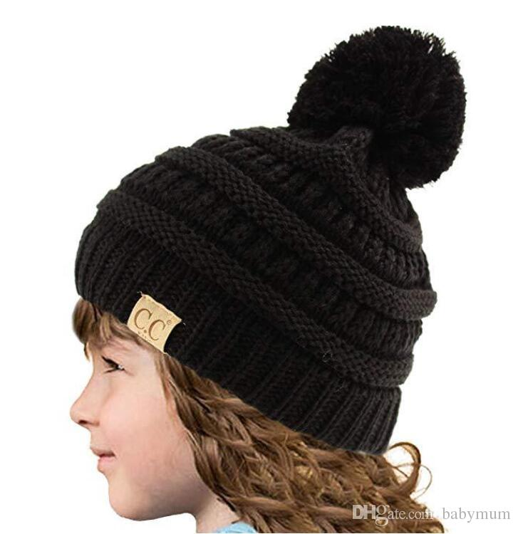 63bf4b1aa47 2019 Kids Crochet Beanie Hats Pompom Hat Girls Baby Cc Label Knit Wool Ball  Beanies Winter Warm Ski Snow Hat Cap From Babymum
