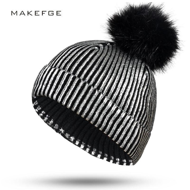 2019 New Knit Black Fur Pompom Hat Gold And Silver Metallic Shiny Warm Beanie  Hats For Women Outdoor Ponytail Beanie Women S Hat Sun Hat Hats For Men  From ... 7d38679891db
