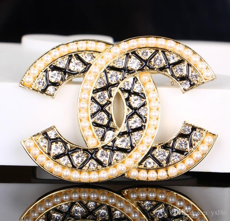 6459343bddc 2019 2019 Famous Brooches Hot Crystal Rhinestone Letter Brooch Pin Hollow  Corsage Brooches Women Fashion Jewelry Costume Decoration 007 From Yxl86,  ...