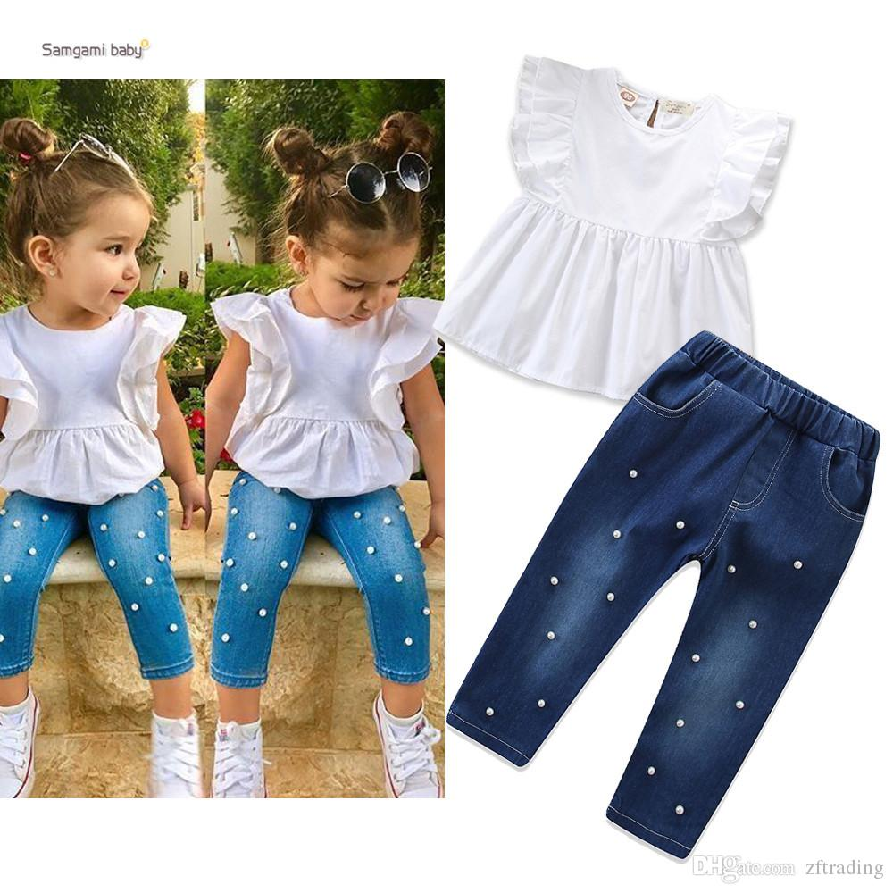 a0084629dee New design baby girls outfits white short sleeve T-shirt tops+denim jeans  pant with pearl 2 pcs girl clothes set children boutiques suit