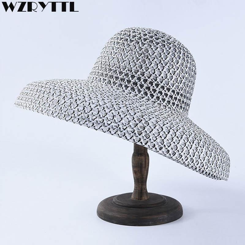 15f62ff3dcbe3 Classical Black White Paper Straw Women Summer Hat 12cm Wide Brim Hat  Cloche Sun Beach Cap Floppy Fedoras UV Floppy Hats Black Floppy Hat From  Splendone