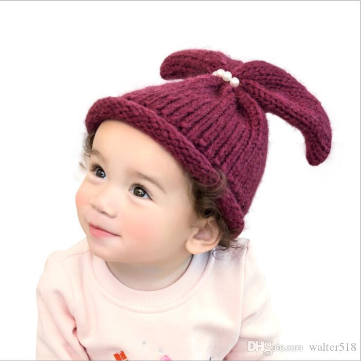 c1549501ad4 2019 Baby Winter Cute Ear Hats Kids Knitted Caps Boys Girls Hats Beanie Caps  Accessory Bow NM 018 From Walter518