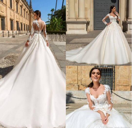 1ace105114ca Discount 2019 New Design Sheer Neck Illusion Long Sleeves Lace A Line  Wedding Dresses Lace Applique Court Train Bridal Wedding Dresses Custom  Made Halter ...