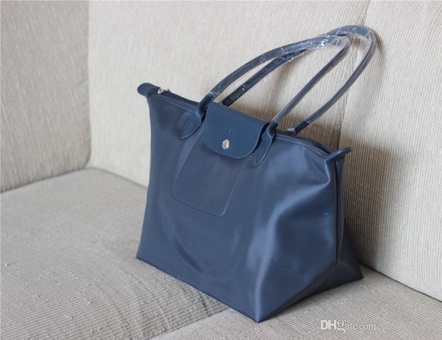 5a83a8f542fb Fashion Brand Designer Long Handle Women Nylon Waterproof Handbags Thick Women S  Shoulder Bag Casual Totes Shopping Bag Cute Purses Rosetti Handbags From ...