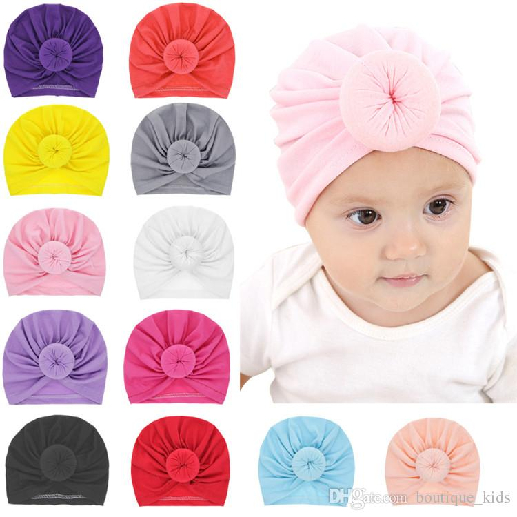 0b0eee6b166 2019 Baby Hats Girls Solid Colored Donut Hat BeBe Turban Knotted Cap Cotton Cute  Hats Newborn Infant Toddler Beanie Kids Accessories From Boutique kids