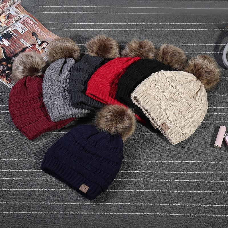aa2421e9d0a Winter Stylish Women Faux Fur Pom Pom CC Knitted Beanie Hat Warm Thicker  Skullies Hats Fashion Bonnet Solid Beanies Caps Fedora Hat From Gaiming