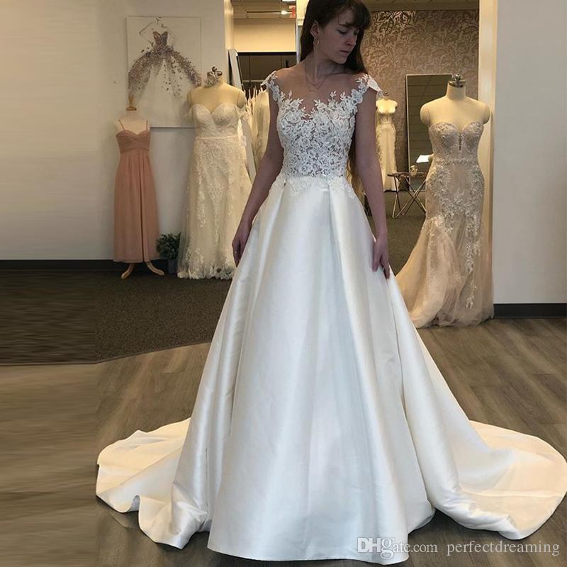 Discount Western Country A Line Wedding Dresses Illusion Bodice Lace  Appliques Sleeveless Long Bohemian Bridal Gowns Plus Size Robe De Mariée  Wedding ... f766d466654a