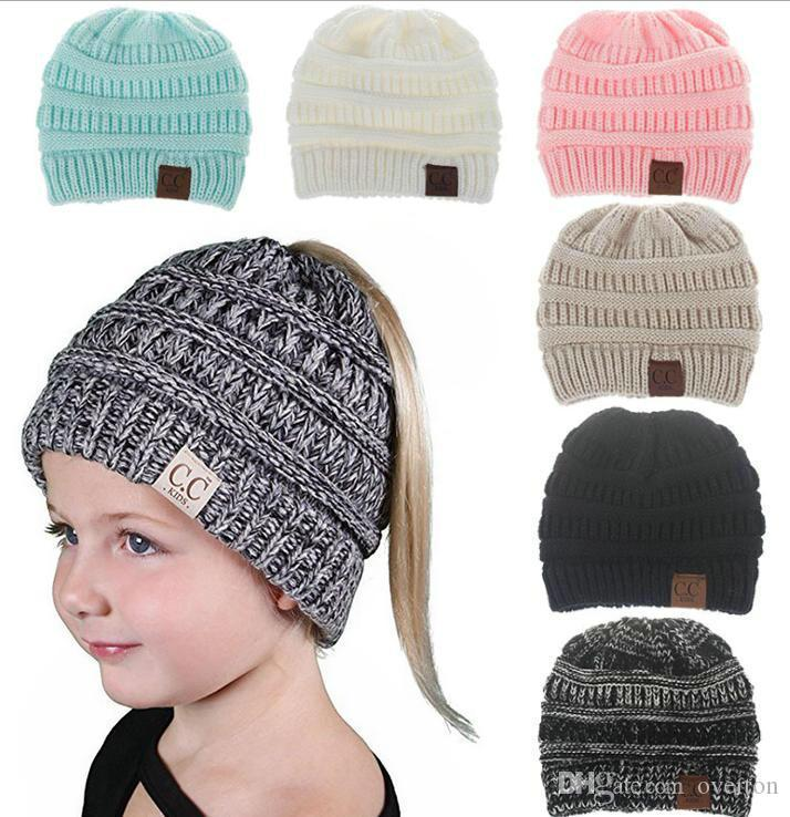 7799371c9b4 CC Beanie Tail Kids  Children S Soft Cable Knit Messy High Bun Ponytail  Beanie Hat Cloche Hat Crochet Hats From Overton
