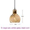 large, amber glass, black cord