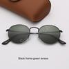 Las lentes de marco negro verde