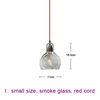 small, smoke glass, red cord