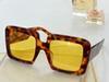 Amber framed yellow lenses