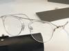 Clear frame transparent lens