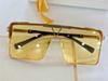 altın çerçeve sarı lens