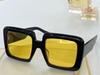 Black frame with yellow lenses