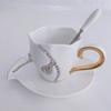 Cup and saucer white