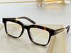 Amber framed clear lenses