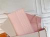 Plaid blanc avec doublure rose