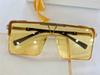 Black gold frame with yellow lenses